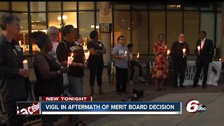 Demonstrators hold vigil after Merit Board decision not to fire officers - Video