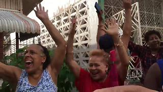 Video captures neighborhood's joy as We Energies crews restore power in Puerto Rico - Video