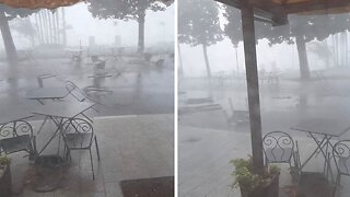 TERRIFYING MOMENT VIOLENT STORM SWIPES RESTAURANTS' CHAIRS AND TABLES ACROSS STREET