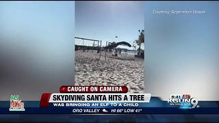 Skydiving Santa meets match with tree - Video