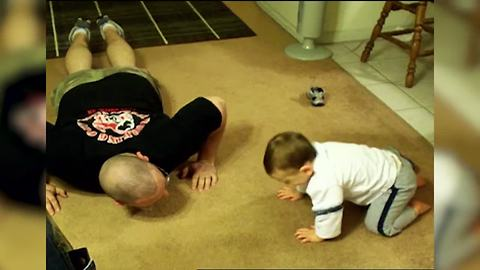 Baby Tries to Mimic Dad's Push-ups