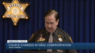 Couple charged in viral confrontation in Orion Township