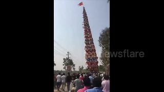 Terrifying moment 100-foot chariot falls on power lines - Video