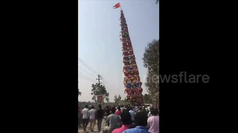 Terrifying moment 100-foot chariot falls on power lines