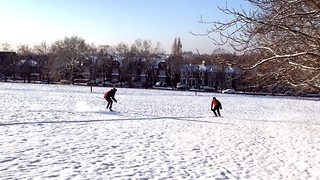 Chill seekers make most of beast from east by snowboarding in London - Video