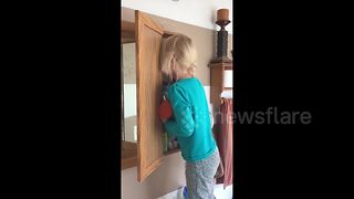 Girl Hides Face In Medicine Cabinet After Using Her Mother's Makeup - Video