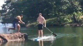 Guy tackled off of paddleboard LOL