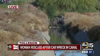 Woman hurt in crash into canal