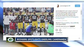 Rodgers jokes: Cameramen take knee during anthem - Video