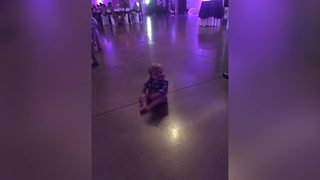 """A Baby Boy Dances to Music at A Wedding While Sitting Down"""