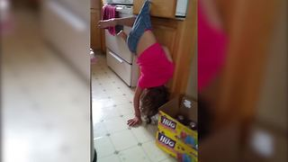 """Little Girl Hangs By Her Shorts On Drawer Handle"""