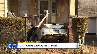 One person injured after car crashes into house on Cleveland's east side