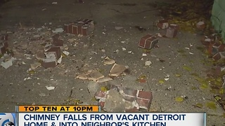 Chimney falls from vacant Detroit home into neighbor's house - Video