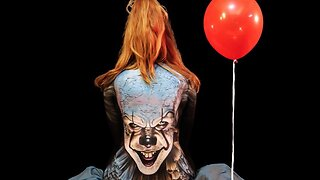 Talented body painting artist recreates scary pennywise face on woman's back