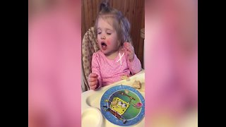Little Girl won't let Sleep Keep her from Eating - Video