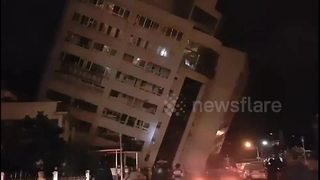 'Guests trapped' as Taiwan hotel collapses in quake - Video