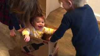 Baby Has the Time of Her Life Playing With Wine Box