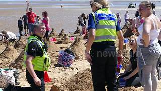 Police lend a hand to try to break sandcastles record in Cleethorpes - Video