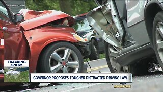 Governor backs bipartisan bill allowing police to pull drivers over for using their phones