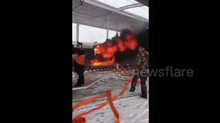 China bullet train bursts into flames at station - Video