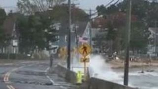 Waves Splash Over Seawall on Connecticut Shoreline - Video