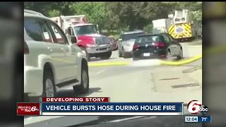 Indianapolis Fire Department wants to know who ran over one of their hoses at a fire scene - Video