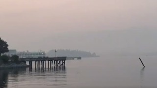 Mountains Around Vancouver Disappear Behind Canadian Wildfire Smoke - Video