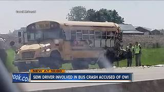 Truck driver arrested for OWI after crash with school bus - Video