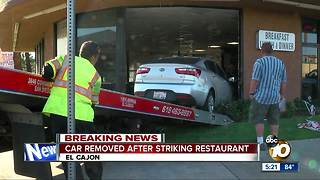 Car removed after striking restaurant in El Cajon - Video