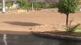 Floodwaters rage through street after heavy storm hits El Paso, Texas - Video