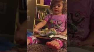 Adorable Girl Reads Bedtime Story to Her Dad - Video