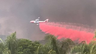 Boeing 747 Joins Fight Against California's Holy Fire - Video
