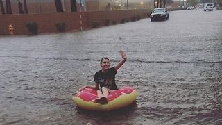 Heavy Rain Turns Phoenix Streets Into Rivers Perfect for a Doughnut Float - Video