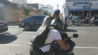 Motorist wrestles with biker after alleged hit-and-run - Video
