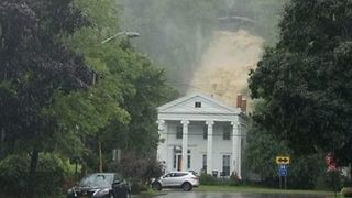 Waterfall Thunders Down Behind House in Montour Falls - Video