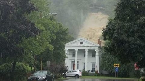 Waterfall Thunders Down Behind House in Montour Falls