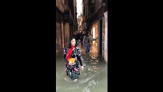 People Wade Through Flooded Venice Streets