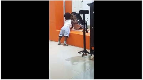 Funny baby caught kissing his own reflection