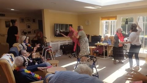 A day to remember: UK care home hosts first-ever silent disco for dementia patients in bid to stem the effects of the deadly condition