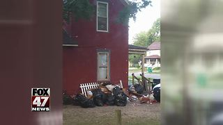 Neighbors concerned about trash piling up outside Mid-Michigan home - Video