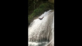 Daredevil dives off waterfall in epic slow motion