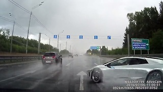 Cringeworthy Footage Of A Lamborghini Hydroplaning Into A Car  - Video