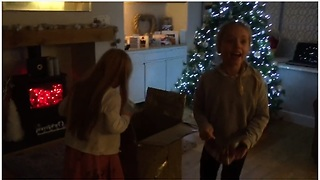Girls unwrap surprise puppy for Christmas - Video