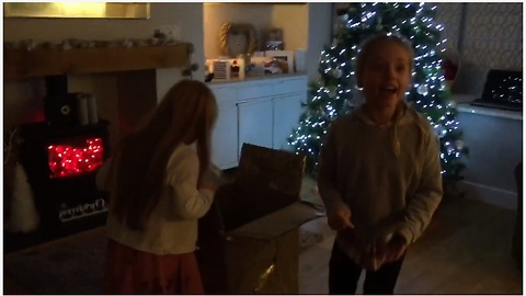 Girls unwrap surprise puppy for Christmas