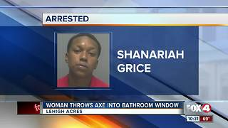 Woman Throws Axe into Bathroom Window - Video