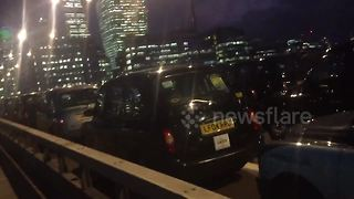 Black cab protest blocks London Bridge for hours - Video