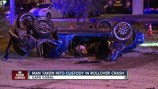 Man Taken into Custody in Rollover Crash - Video