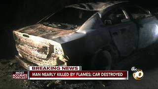 Man nearly killed by flames; car destroyed - Video