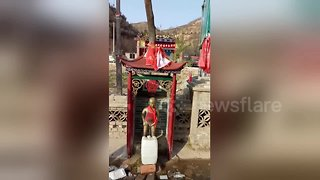 Chinese villagers build 'peeing boy' statue to divert spring water from mountain