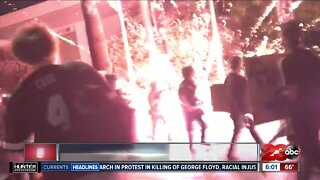 Protester detonates firework in front of Bakersfield police units during protest